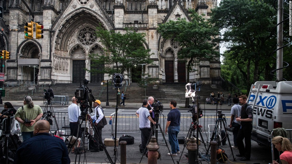Members of the media congregate outside the Cathedral Church of St. John the Divine in New York City prior to the funeral of James Gandolfini on Thursday, June 27.