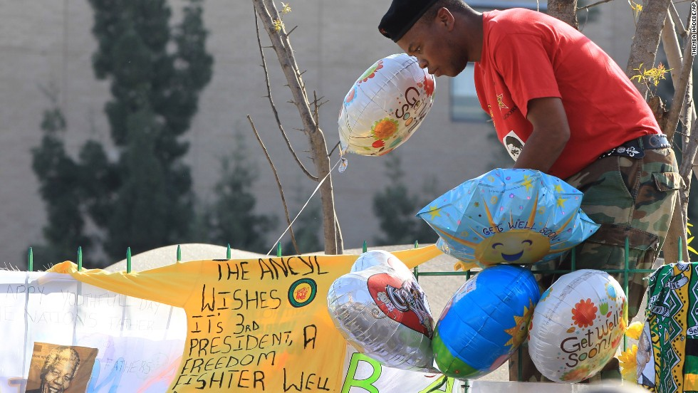 A youth league member wishes Mandela well in a banner on a fence near the hospital on June 27.