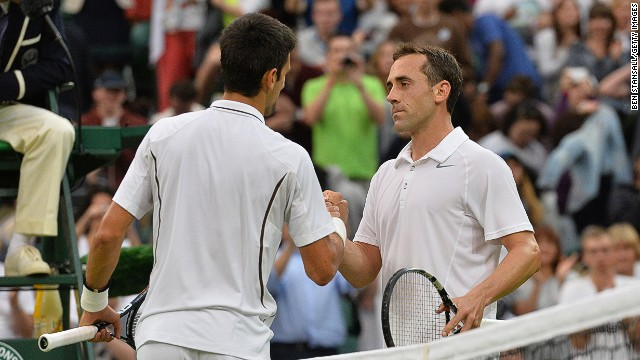 Novak Djokovic shakes hands with Bobby Reynolds, the 11th and last American to exit the men's singles.