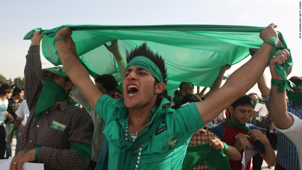 Supporters of Iranian presidential candidate Mir Hossein Mousavi shout slogans during a street campaign rally at Azadi Square in Tehran on June 10, 2009. The color green became a symbol of solidarity in the protests that followed the country's 2009 elections.