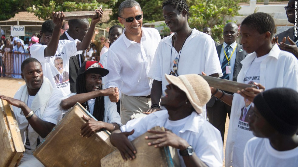 Obama speaks with locals as he tours Goree Island off the coast of Dakar on June 27.