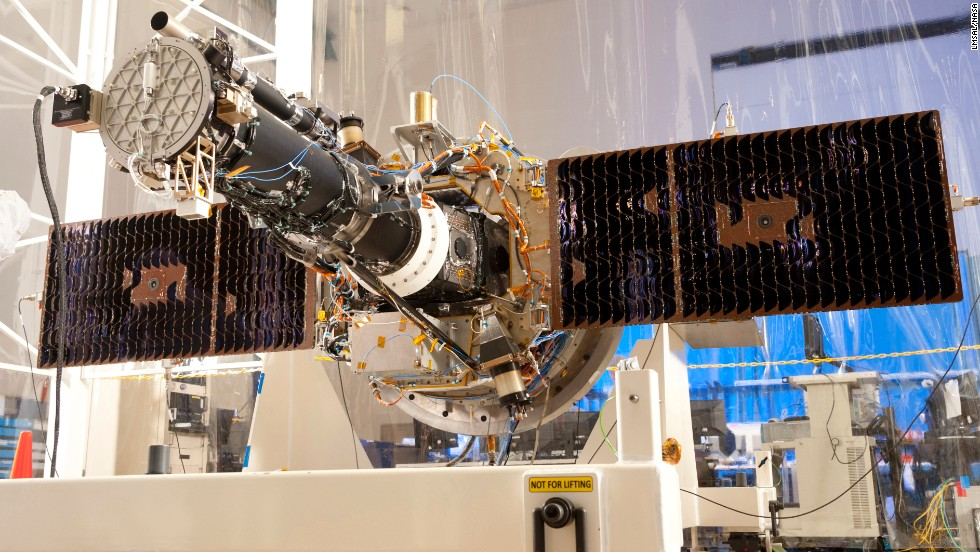 NASA's Interface Region Imaging Spectrograph (IRIS) is seen with its solar panels open during testing at a Lockheed Martin facility in California.