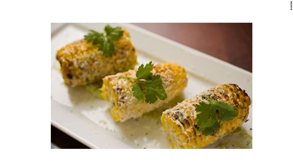 To rest well, you've got to eat well. Star chef Todd English serves his signature Argentinean, European and American fusion (including this gourmet corn) at Bonfire Restaurant in Terminal B.