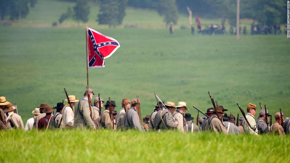 Confederate troops move into position during a reenactment of the Battle of Gettysburg on June 28. The event is taking place at Bushey Farm, outside park property.
