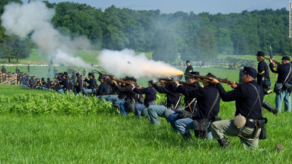 Union soldiers fire a volley at Confederate troops.
