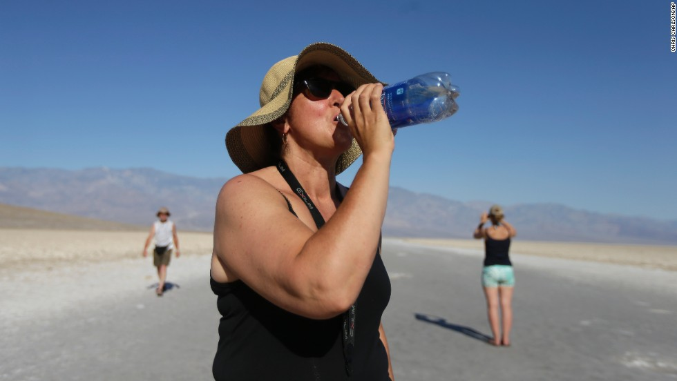 Maria Wieser of Italy takes a drink of water while sightseeing in Death Valley National Park in California on June 28.