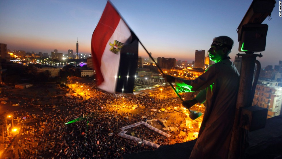 A  protester waves a national flag over Tahrir Square on Friday, June 28.