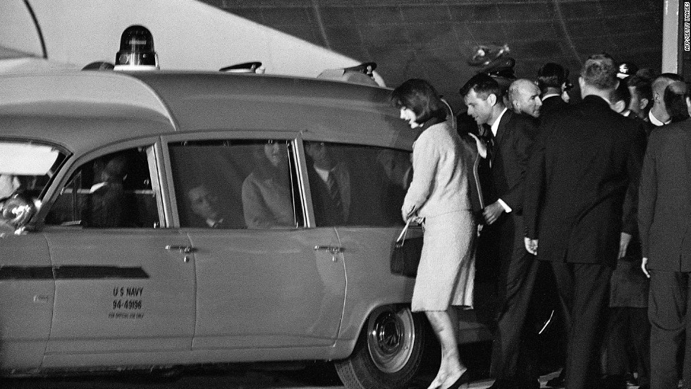 "The president's brother, Attorney General Robert Kennedy, was anxious to board the plane after it arrived. Shown here with the first lady, RFK ""leaped up"" the airline stairs in a rush to console Mrs. Kennedy, according to historian Steven Gillon. He ""pushed his way down"" the aisle past President Johnson ""without saying a word."" Johnson ""fumed that Kennedy would board the plane without even acknowledging him,"" Gillon wrote in ""The Kennedy Assassination, 24 Hours After."""