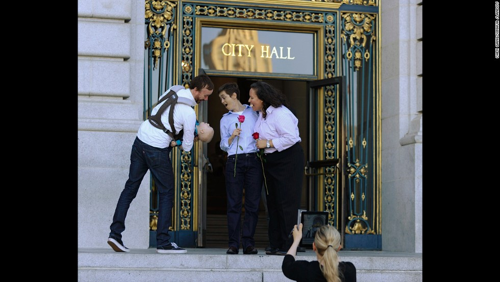 A couple come out of City Hall after obtaining their marriage license in San Francisco on Friday, June 28.