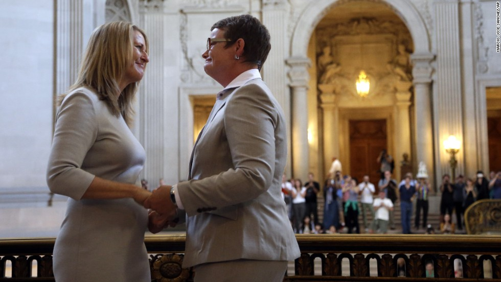 Sandy Stier, left, exchanges wedding vows with Kris Perry during a ceremony presided over by California Attorney General Kamala Harris at City Hall in San Francisco on Friday, June 28. Stier and Perry were two of the four lead plaintiffs in the U.S. Supreme Court case that overturned California's same-sex marriage ban.