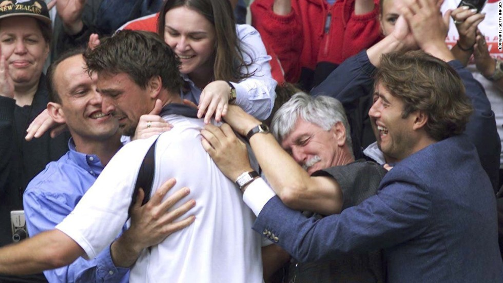 Ivanisevic climbed into his players' box to celebrate with his team, which included his father Srdjan, second from right. Srdjan had recently undergone heart surgery.