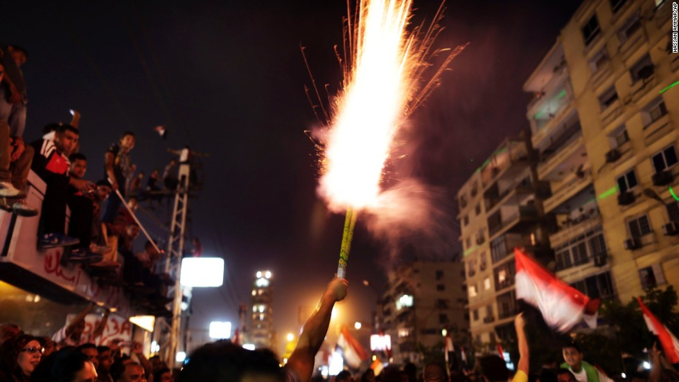 Protesters set off fireworks on June 30 outside the presidential palace.