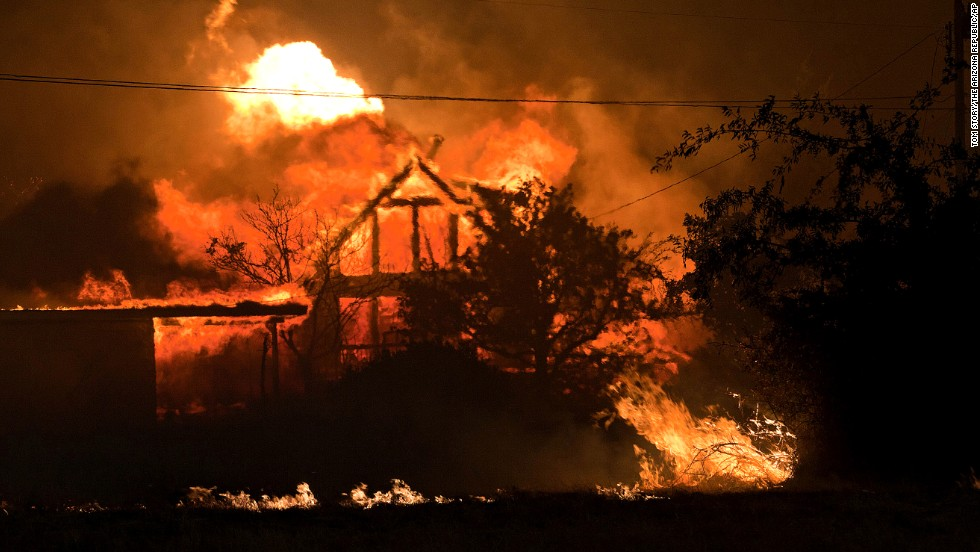 A home burns in Yarnell, Arizona, on Sunday, June 30.