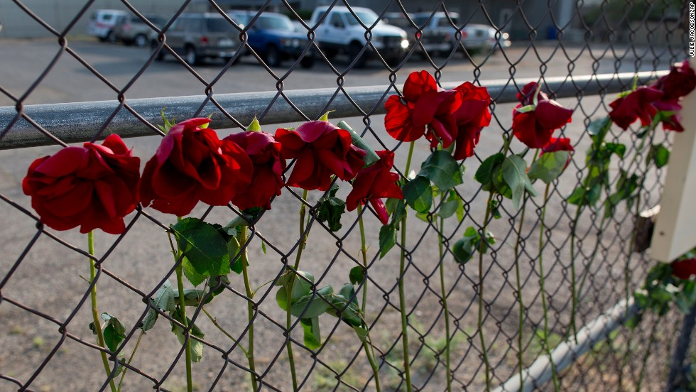 Flowers hang on the fence outside the Granite Mountain Hot Shot Crew fire station on July 1.