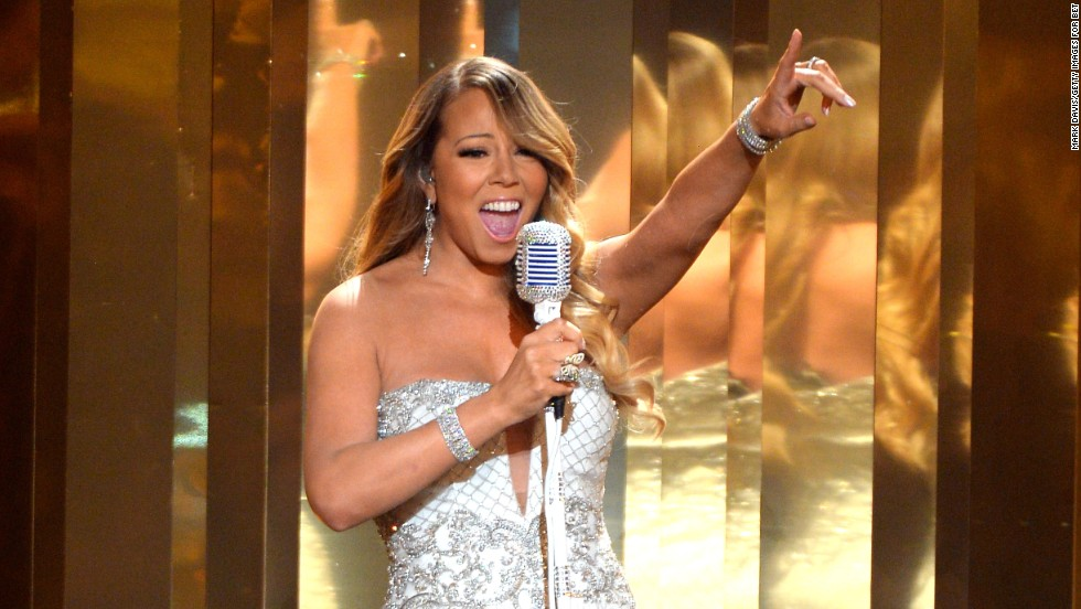 "Mariah Carey goes for the high notes while performing ""Beautiful"" at the 2013 BET Awards on June 30."