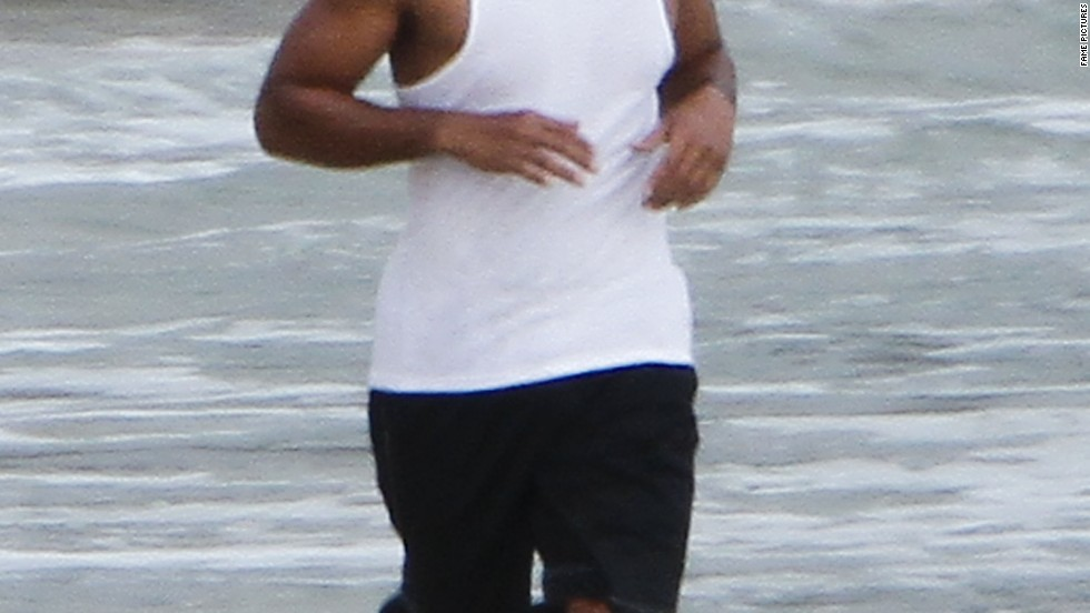 Will Smith gets in a run along the beach while in Hawaii on June 28.