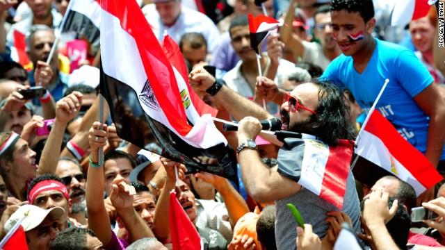 Opponents of Egypt's Islamist President Mohamed Morsy shout slogans during a protest