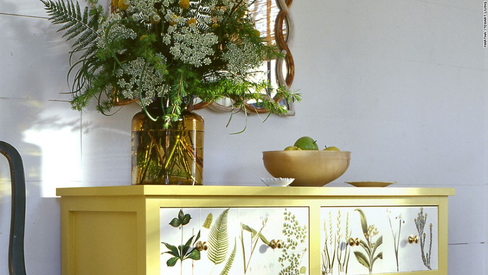 What began as an unremarkable piece of furniture becomes a bold, modern design statement when adorned with leaves and vines. <br /><br />Click on the double arrow below to find more tips for shopping at flea markets and yard sales.