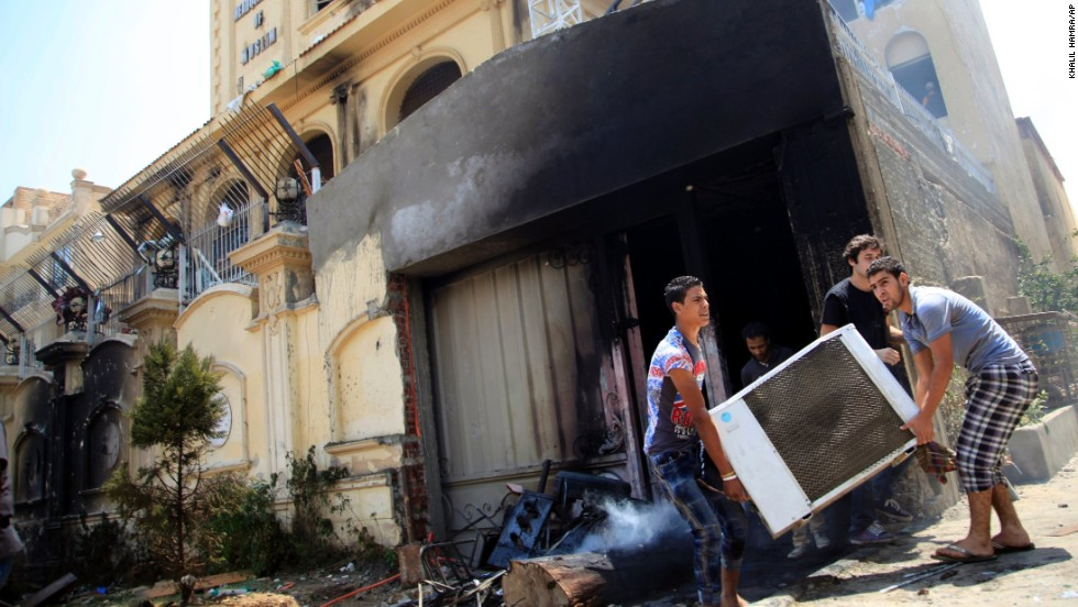 Egyptian protesters ransack the Muslim Brotherhood headquarters in Cairo on July 1.