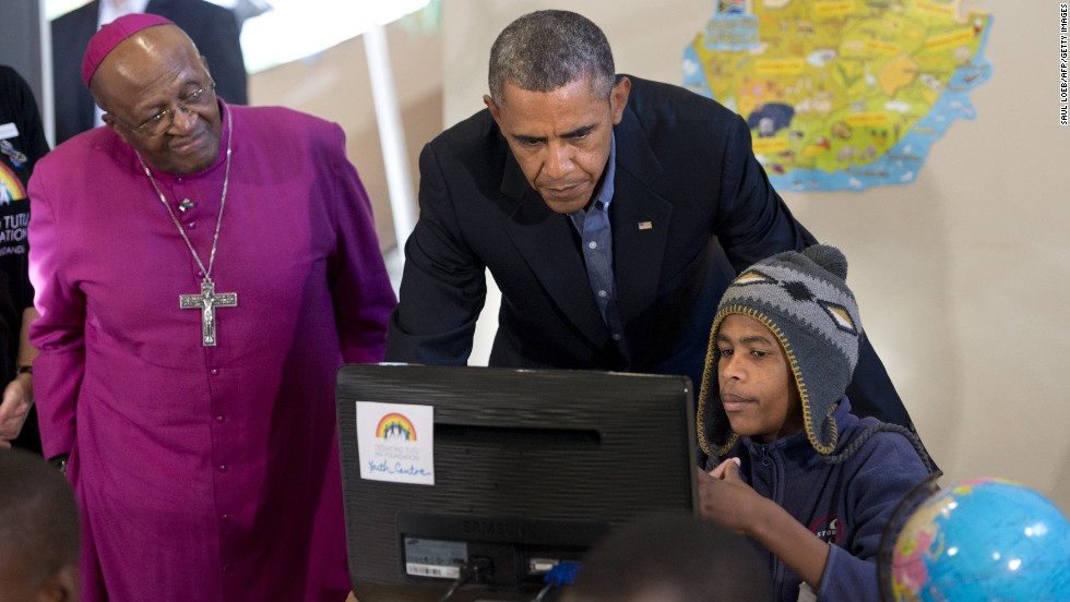 Obama visits the Desmond Tutu HIV Foundation Youth Centre with Nobel peace laureate Archbishop Desmond Tutu and 15-year-old Aviwe Mtongana in Cape Town on June 30.