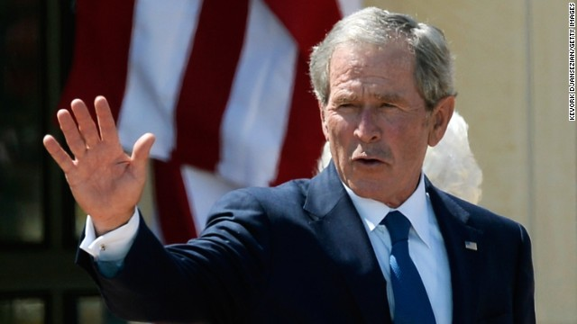 Former President George W. Bush waves goodbye after attending the opening ceremony of the George W. Bush Presidential Center April 25, 2013 in Dallas, Texas.