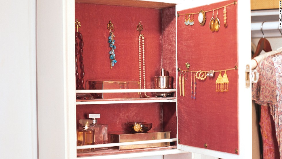 A vintage medicine cabinet is just the right size to stash jewelry, perfume, and other accoutrements.