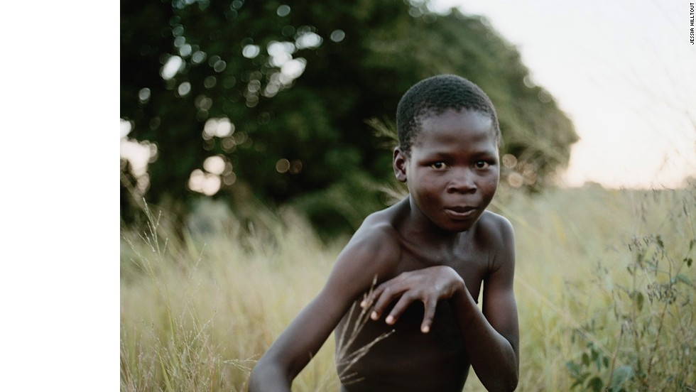 In Nhambonda, Mozambique, this boy had no ball to pose with for the photo so he created an invisible one.
