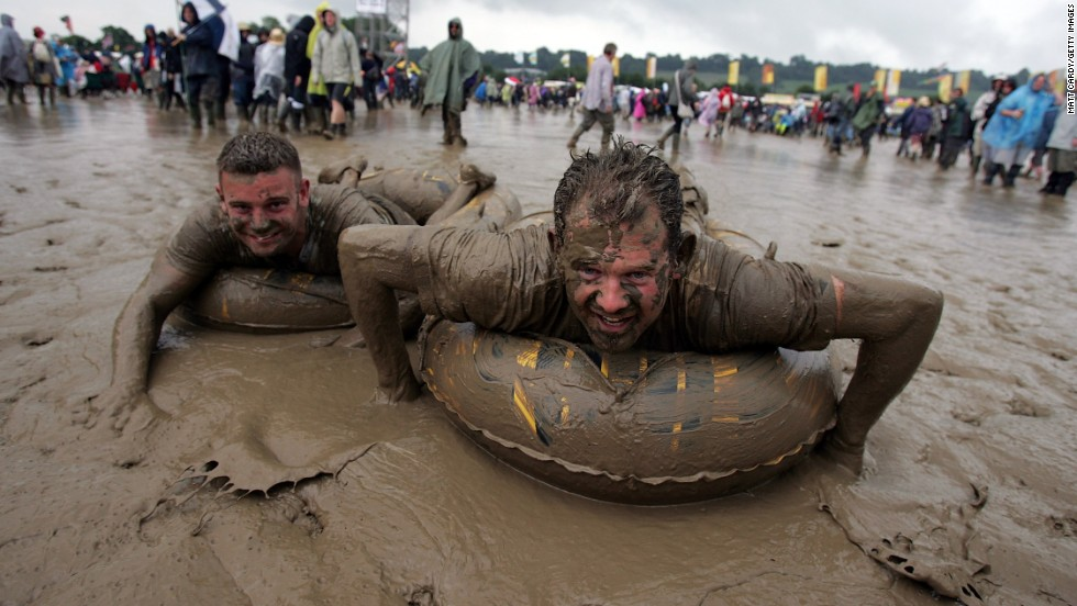 "Glastonbury, the world's biggest music festival, is almost as renowned for its muddy setting as it is music. The festival is often credited with inventing ""mud surfing""."