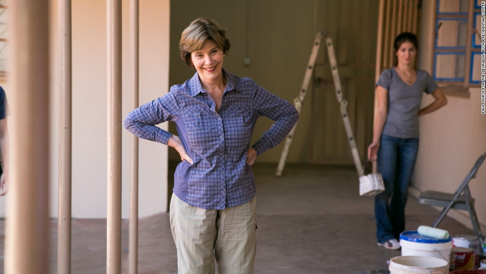 Laura Bush pauses at the Mosi Oa Tuny Clinic.