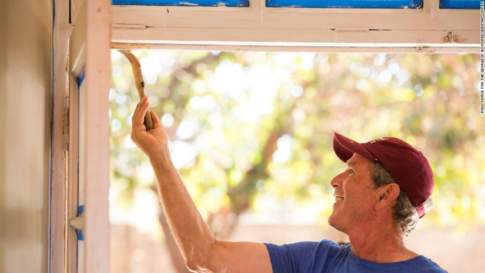 George W. Bush does some painting during renovations.