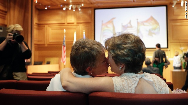 Clerk defies law, OKs same-sex marriages