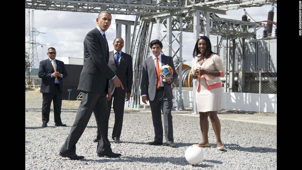 President Barack Obama kicks around an energy-generating soccer ball at a power plant in Dar es Salaam, Tanzania, on Tuesday, July 2. Obama was pushing for partnerships in energy as he concluded a three-nation trip to Africa. Tanzanian President Jakaya Kikwete, third from right, joined Obama at the Symbion Power Plant at Ubungo.