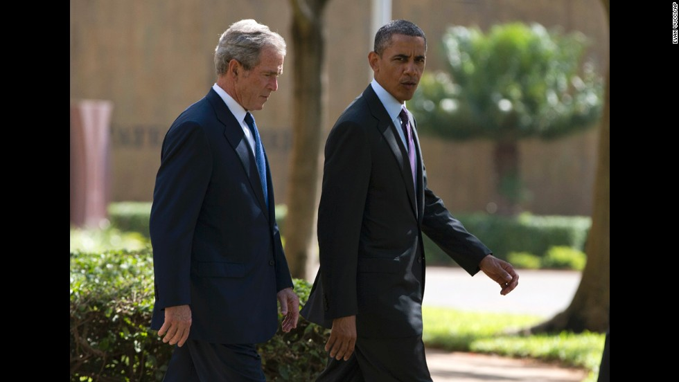 Former President George W. Bush joins Obama during a July 2 wreath-laying ceremony in Dar es Salaam to honor the victims of the 1998 terror attack at the U.S. Embassy in Tanzania.