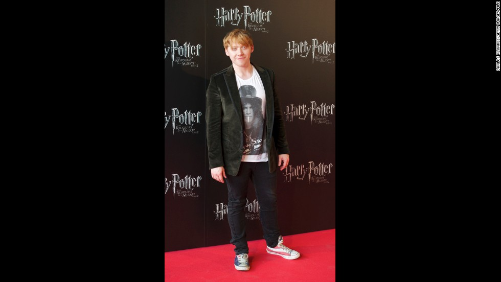 """Rupert Grint walks the red carpet in red, white and blue sneakers at the Madrid premiere of """"Harry Potter and the Deathly Hallows: Part 2"""" in June 2011."""