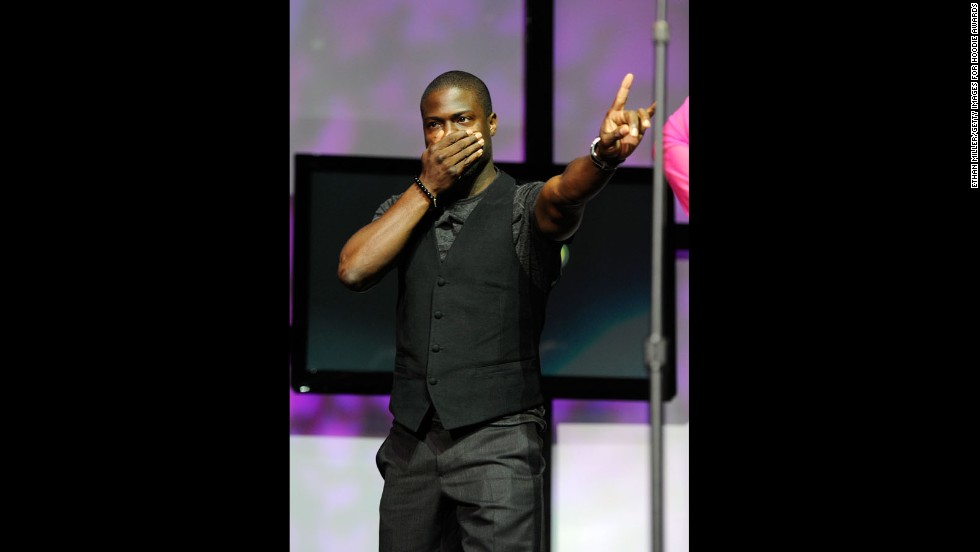 The comedian peaks onstage during the ninth annual Ford Hoodie Awards at the Mandalay Bay Events Center on August 13, 2011, in Las Vegas.