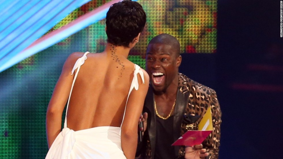 Singer Rihanna accepts the award for Video of the Year from host Kevin Hart onstage during the 2012 MTV Video Music Awards at the Staples Center on September 6, 2012, in Los Angeles.