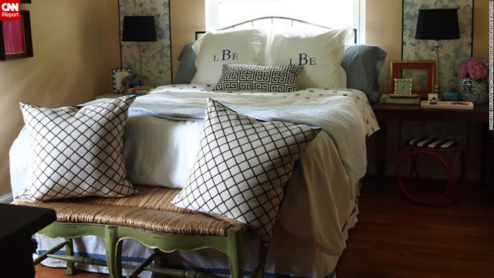 """<a href=""""http://ireport.cnn.com/docs/DOC-996853"""">Elizabeth Baumgartner</a> of St. Louis said her bedroom sat neglected while she worked on decorating the rest of her house. Through smart purchases and repurposed items from the rest of her home, she transformed her bedroom and documented the process <a href=""""http://thelittleblackdoor.blogspot.com/2012/05/now-i-can-lay-down-bedroom-reveal.html"""" target=""""_blank"""">on her blog</a>."""
