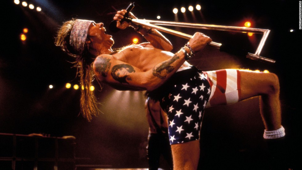 Axl Rose rocks out in flag biker shorts at a '90s Guns N' Roses show.