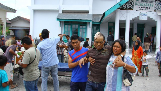 Quake survivors are pictured outside the hospital in Lampahan village in Aceh province on Tuesday.