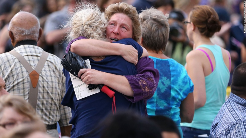 "Family members of victims hug as they arrive at a vigil at Prescott High School on July 2. <a href=""http://www.cnn.com/2013/07/02/us/gallery/hot-shot-victims/index.html"">The elite team members' deaths</a> on Sunday, June 30, marked the deadliest day for U.S. firefighters since the 9/11 attacks."