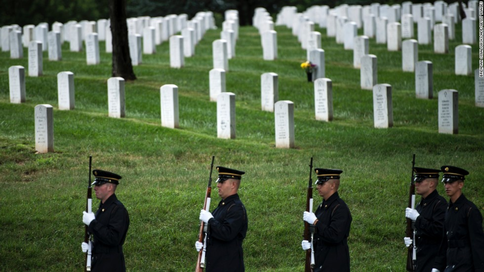 A firing party from the U.S. Army's 3rd Infantry Regiment, the Old Guard, arrives in Section 60 of Arlington National Cemetery on Tuesday, July 2, for the burial of the remains of three soldiers killed in Vietnam in 1970.