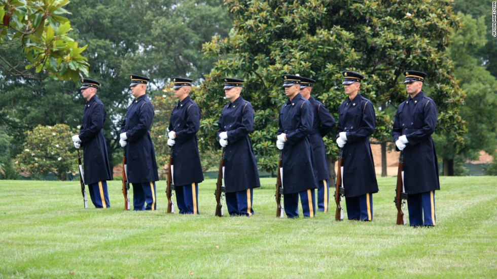 The firing squad stands at attention during the burial service.