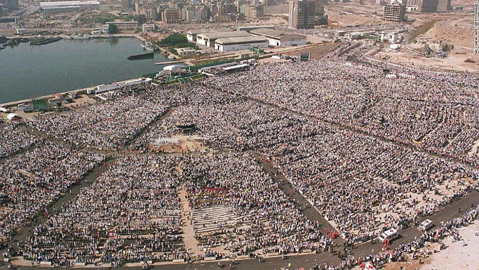 Hundreds of thousands of pilgrims attend an open-air Mass celebrated by Pope John Paul II in Beirut, Lebanon, in May 1997. The pontiff drew vast crowds as he crisscrossed the globe.