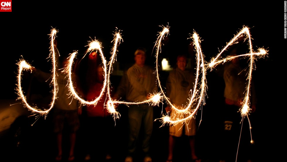 "Tyler Knott took this photo on July 4, 2009, of family and friends light painting ""July 4"" in Helena, Montana. He says despite the challenges -- each sparkler-holder had to <a href=""http://ireport.cnn.com/docs/DOC-996398"">draw a letter backwards</a> -- they nailed the photo on the first try."