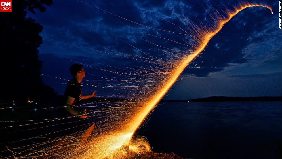 "Dan Anderson managed to capture the moment his nephew <a href=""http://ireport.cnn.com/docs/DOC-996552"">launched a bottle rocket</a> across Minnesota's Lake Koronis, during Fourth of July 2012. They had carefully prepared everything to take the perfect photo, counting the seconds it took from lighting the fuse to the explosion of the firework and arranging the camera on a tripod. ""We did it in one take and then ran away because the mosquitoes were eating us alive,"" Anderson says."