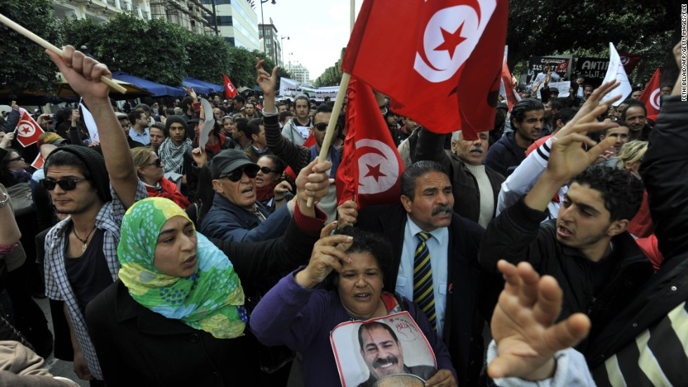 "People demonstrate in Tunis in March to mark the 40th day of mourning after the death of Chokri Belaid, a vocal critic of Tunisia's Islamist-led government. <a href=""http://www.cnn.com/2013/02/06/world/meast/tunisia-opposition-leader-killed"">Belaid, 48, was gunned down</a> outside his home in a Tunis suburb in February. His assassination set off a wave of political instability in Tunisia, which had been widely hailed as the poster child of the Arab Spring."