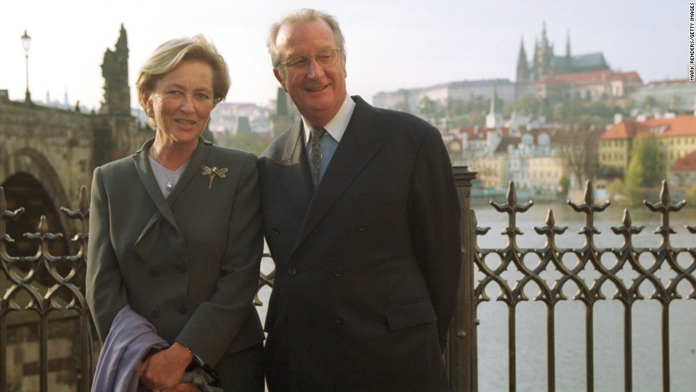 King Albert II and Queen Paola pose in front of the Charles Bridge and Prague Castle on October 24, 2000, in Prague, Czech Republic.