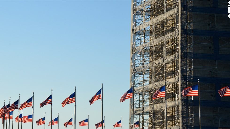 The Washington Monument is closed for repairs following the 2011 earthquake in DC, but the ring of flags still fly.