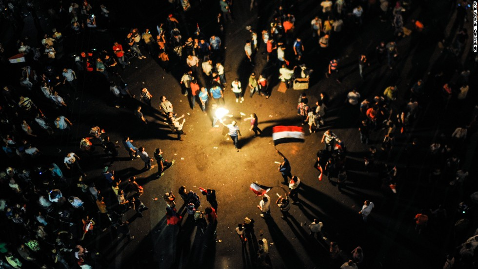 Protesters celebrate near Egypt's Presidential Palace in Cairo on July 3 after the military deposed Morsy.