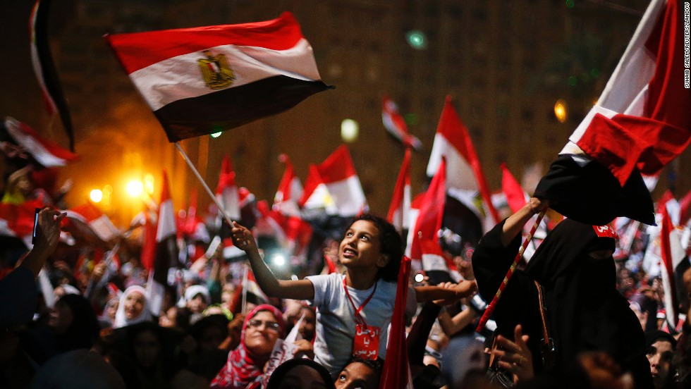 Anti-Morsy protesters wave flags in Tahrir Square on July 3.